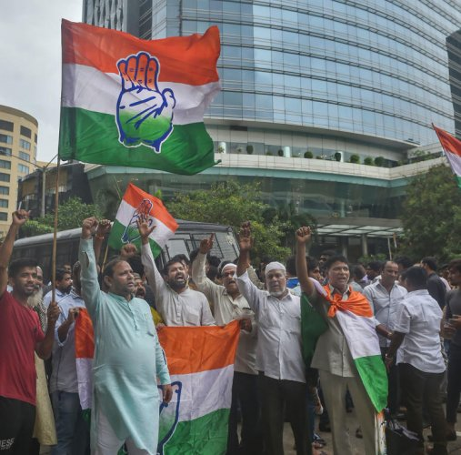 Congress party supporters shout slogans as they protest over the meeting of some Karnataka Congress MLAs with BJP party leaders outside a hotel in Mumbai, Sunday, July 7, 2019. (PTI Photo)