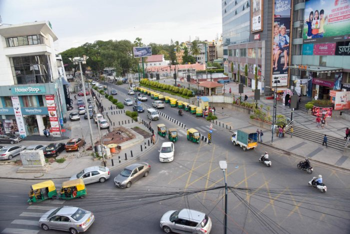 The 500-metre stretch near Garuda Mall is one of two roads in Bengaluru with contra-flow traffic, where vehicles are expected to keep right. DH PHOTOS BY B H SHIVAKUMAR