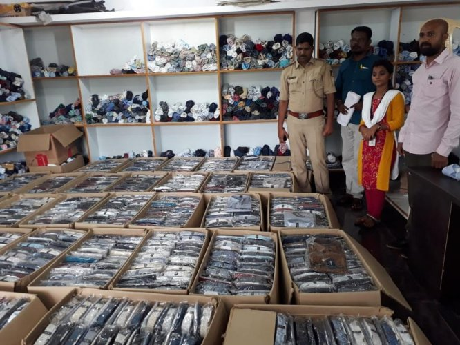 The fake garments of reputed brands seized by the police at a garment-making unit near Honnavar, Uttara Kannada district on Saturday.