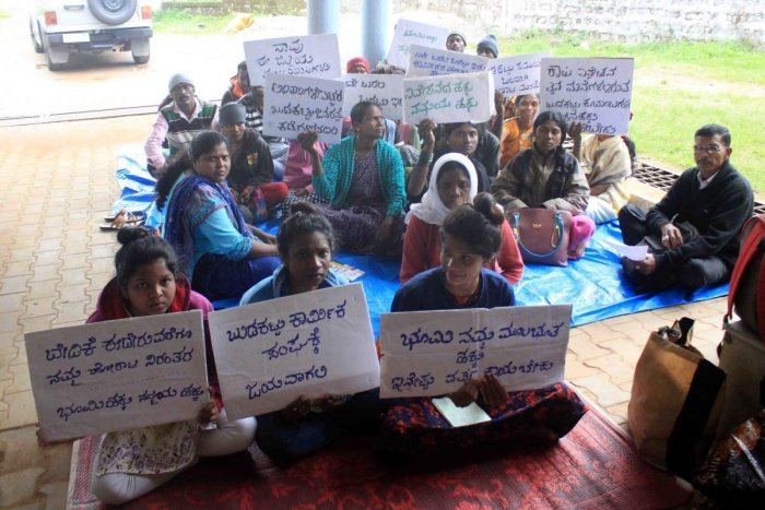 People of tribal communities staged a protest in front of ITDP office in Madikeri.