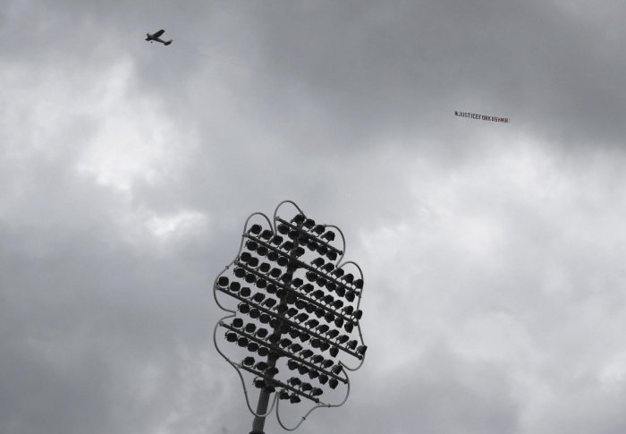 """Leeds: An aircraft tows a banner which reads """"Justice for Kashmir"""" as it flies over the venue of the Cricket World Cup match between India and Sri Lanka at Headingley in Leeds, England, Saturday, July 6, 2019. AP/PTI(AP7_6_2019_000083B)"""