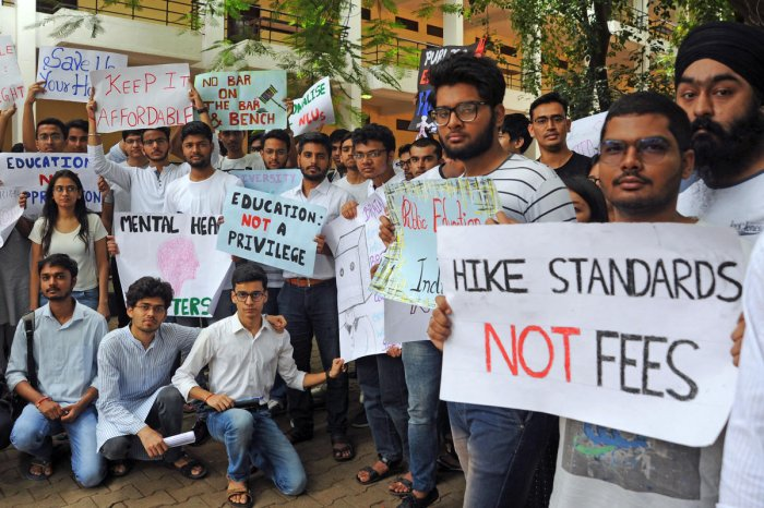 Angered by a substantial hike in college fees, the student body at the National Law School of India University Bengaluru protest to withdraw the increases on Saturday. NLSIU has hiked the fee by 25%. | DH Photo/Pushkar V