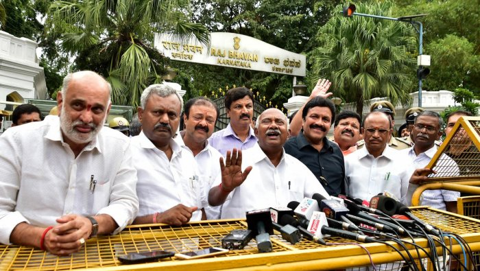 Rebel MLAs address media after submitting a copy of the resignation to the Governor at Raj Bhavan, in Bengaluru on Saturday. DH Photo/Ranju P