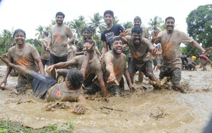 People enjoying in the slush field race organised by the Ganeshotsava Samithi in Alevoor Gram Panchayat on Sunday.