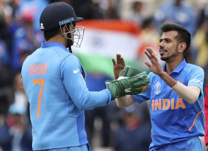 MS Dhoni's gloves will be in focus in India's match against Australia after the ICC forbade him from using army insignia in the gloves. Photo credit: Reuters