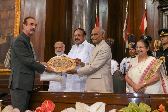 President Ram Nath Kovind confers Outstanding Parliamentarian Award for 2015 to Leader of Opposition in the Rajya Sabha Ghulam Nabi Azad as Vice-President Venkaiah Naidu, Prime Minister Narendra Modi and Lok Sabha Speaker Sumitra Mahajan look on, at the Central Hall of Parliament House, in New Delhi on Wednesday.  PTI