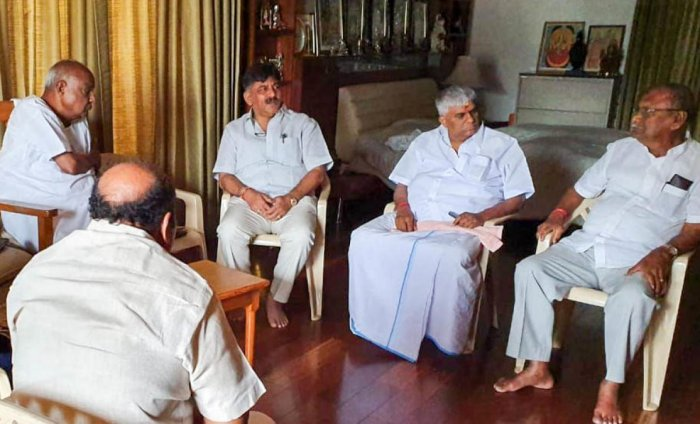 DK Shivakumar with Deve Gowda, PWD Minister HD Revanna and other leaders at Gowda's residence in Bengaluru on Sunday.