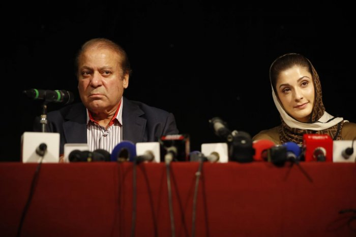 Ousted Pakistani prime minister Nawaz Sharif (L) and his daughter Maryam Nawaz (R) attend a UK PMLN Party Workers Convention meeting with supporters. (AFP File Photo)