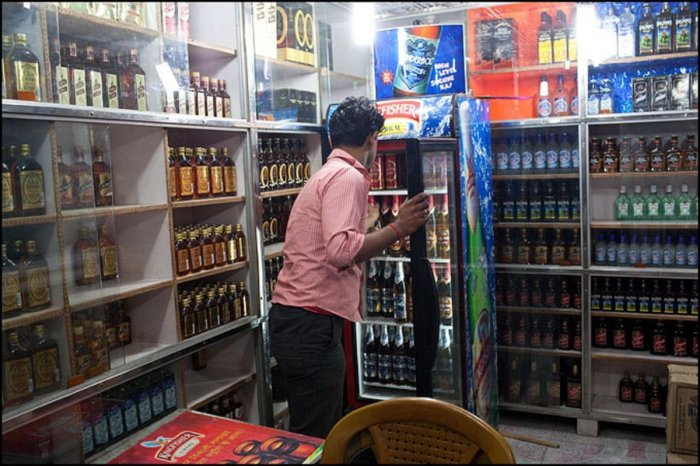 As many as 184.63 lakh boxes of liquor have been sold between April and July against 172.46 lakh boxes during the same period last year. DH File Photo