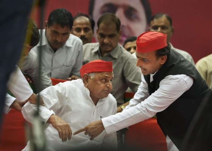 Samajwadi Party founder Mulayam Singh Yadav with SP President Akhilesh Yadav during a public rally last year (PTI File Photo)