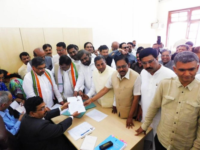 M C Venugopal and Nasser Ahmed of the Congress file their nominations for the by-elections to Legislative Council.