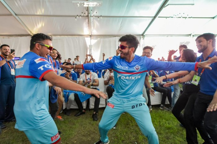 Delhi Capitals captain Shreyas Iyer (right) and team-mate Prithvi Shaw dance with fans before the practice session on the eve of their IPL match against Royal Challengers Bangalore in New Delhi on Saturday. PTI