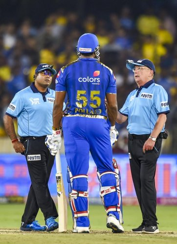 Umpires speak to Mumbai Indians' batsman Kieron Pollard after he expressed his displeasure over a decision in the final against Chennai Super Kings on Sunday. PTI