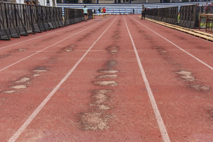 The poor state of the synthetic track at the Sree Kanteerava stadium.