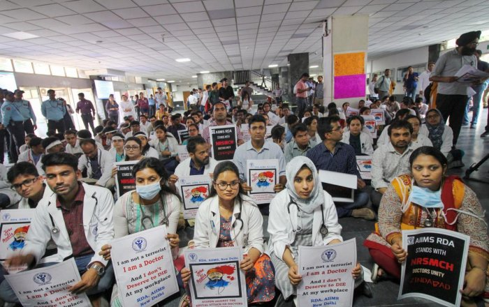 Members of the AIIMS Resident Doctors' Association (RDA) hold placards during a protest to show solidarity with their counterparts in West Bengal last month (PTI File Photo)