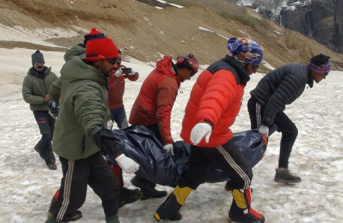 ITBP personnel carry the body of a mountaineer from Nanda Devi at base camp on the mountain before airlifting the remains down to Pithoragarh, Uttarakhand. (ITBP/AFP Photo)