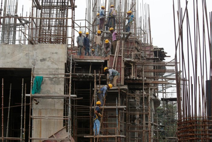 Workers erect scaffolding at a construction site of a metro rail station in Kolkata. REUTERS