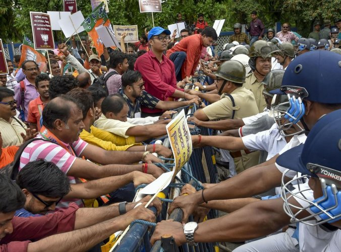 Police personal try to stop the members of West Bengal Teachers cell during their protest against state government in Kolkata on July 7, 2019. PTI