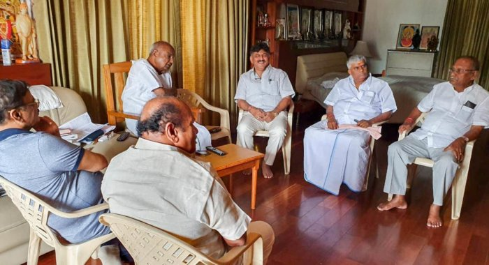 Water Resources Minister D K Shivakumar holds talks with JD(S) supremo H D Deve Gowda at the latter's residence in view of the political crisis in the state, in Bengaluru on Sunday. Rajya Sabha member D Kupendra Reddy, JD(S) state president H K Kumaraswam