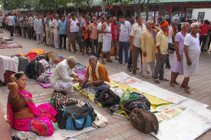 Jammu: Amarnath pilgrims at a base camp after the yatra was suspended due to the third death anniversary of former Hizbul Mujahideen commander Burhan Wani. (PTI Photo)