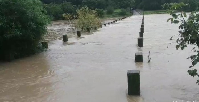 Overflowing Pandri river, a tributary of Kali, leaves Chandbawadi bridge in Joida taluk of Uttara Kannada district submerged.