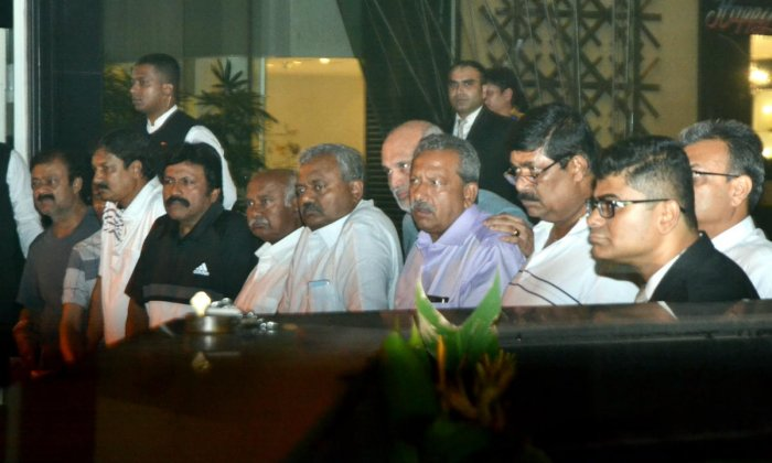 Congress MLAs from Karnataka speak to the media during their ongoing meeting with BJP leaders at a hotel in Mumbai. PTI