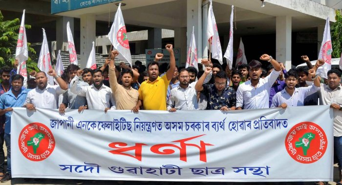 Activists of the All Assam Students' Union (AASU) stage a protest against the authorities' over the deaths due to Japanese Encephalitis outbreak, in front of the State Directorate of Health in Guwahati, Tuesday, July 02, 2019. (PTI Photo)