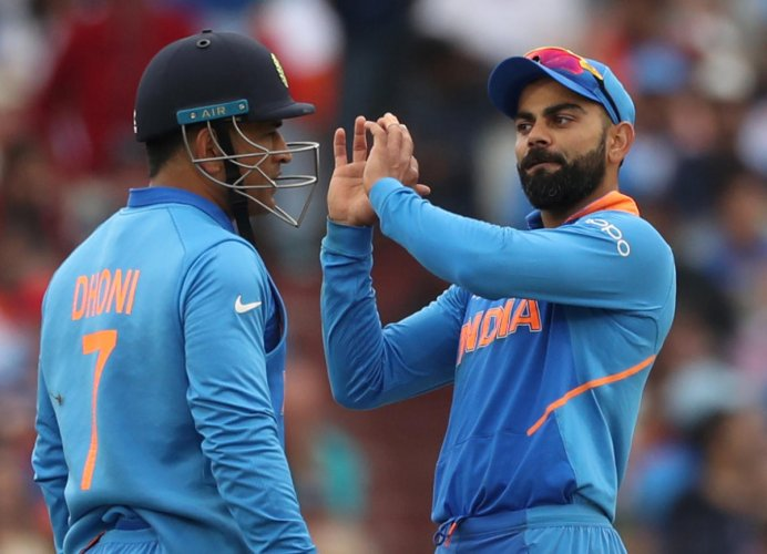 MS Dhoni and Virat Kohli during India's match against New Zealand. Photo credit: Reuters