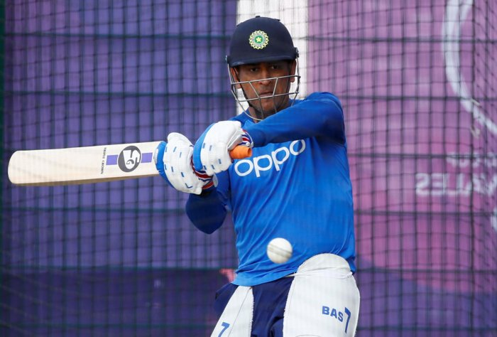 India's MS Dhoni hits one during a training session on Monday. Reuters