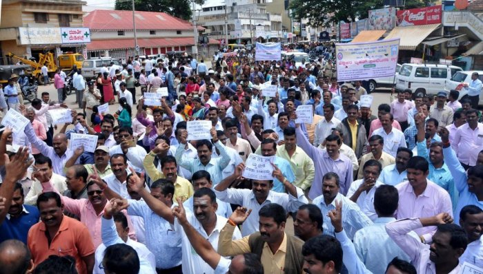 Urging the fulfilment of various demands, primary school teachers take out a protest march in Chikkamagaluru on Tuesday.