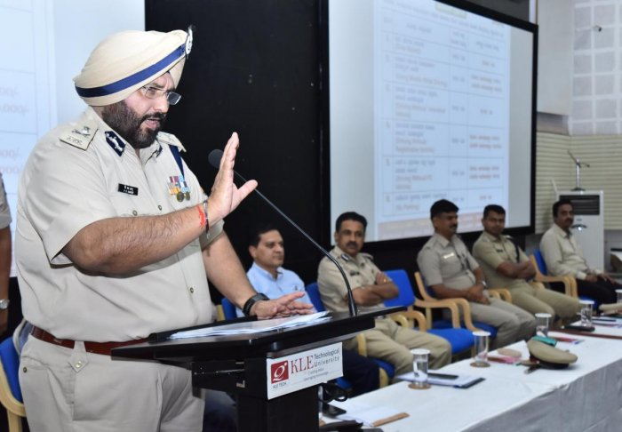 ADGP P S Sandhu speaks at the road safety awareness programme held at the KLETU premises at Vidyanagar in Hubballi on Tuesday.