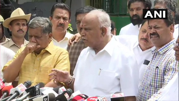 "So we have urged the Governor take appropriate action and ensure that the Chief Minister resigns immediately,"" BJP state unit president B S Yeddyurappa told reporters after meeting the Governor. ANI photo"