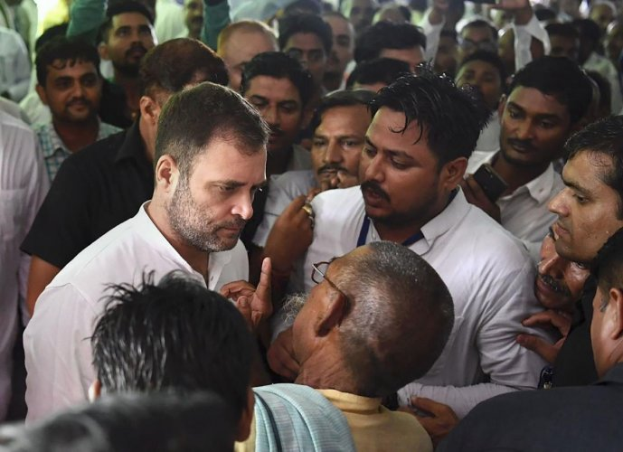 Congress President Rahul Gandhi listens to a party worker during his visit to Amethi on Wednesday. PTI photo