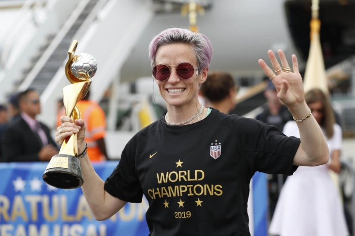 United States women's soccer team member Megan Rapinoe holds the Women's World Cup trophy (PTI Photo)