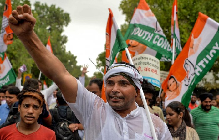 """Activists of opposition Congress party's youth wing protest against alleged """"horse trading"""" of lawmakers by Bharatiya Janta Party (BJP) to topple the Congress-JD(S) coalition in Karnataka in New Delhi on July 9, 2019. (AFP)"""