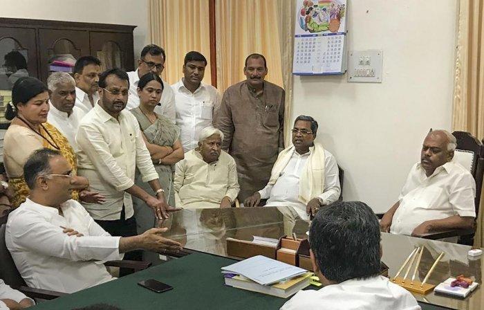 Karnataka Pradesh Congress Committee president Dinesh Gundu Rao, party leaders H K Patil, Siddaramaiah and others leaders meet Assembly Speaker K R Ramesh Kumar at the latter's chamber at Vidhana Soudha in Bengaluru on Tuesday. PTI Photo