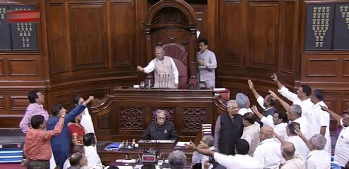 A TV grab of the Oppoisition members staging protest in The Rajya Sabha.