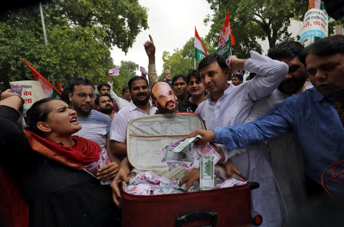 Activists of the youth wing of India's main opposition Congress party shout slogans during a protest against what they say are attempts by the ruling Bharatiya Janata Party (BJP) to topple the Janata Dal (Secular)-Congress coalition government in the sout