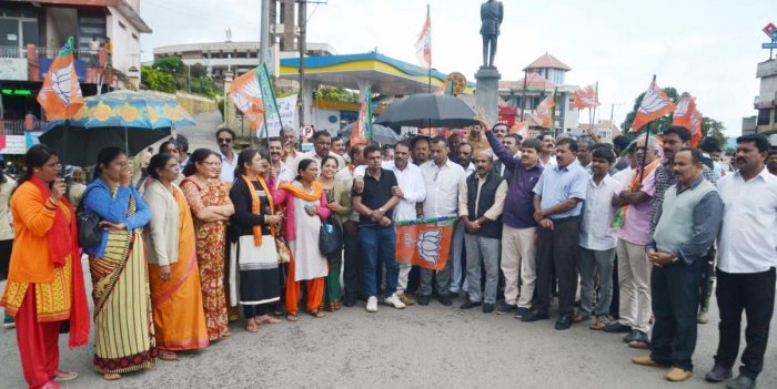 BJP leaders stage a protest at General Thimayya Circle in Madikeri on Tuesday.