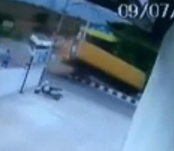 A CCTV Footage of... A school bus belonging to an international school toppled after a Tempo Traveller whose driver lost control and collided with the side of the bus causing it to topple at Ragihalli Gate in Bannerghatta on Tuesday.