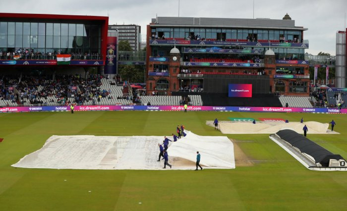 General view of Old Trafford as ground staff remove the covers after a rain delay. (Reuters Photo)