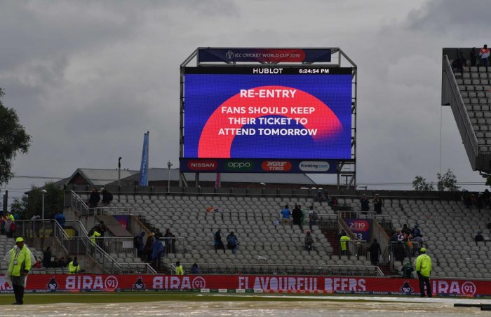A big screen board gives spectators information after the suspension of play for the day in the 2019 Cricket World Cup first semi-final between India and New Zealand at Old Trafford in Manchester, northwest England, on July 9, 2019. (AFP)