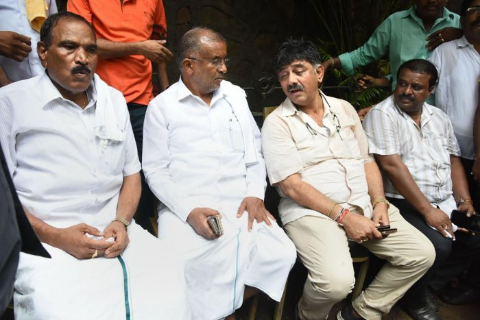 Karnataka Minister D K Shivakumar and G T Devegowda at a hotel in Mumbai, Wednesday, July 10, 2019. Shivakumar, who was accompanied by senior JD(S) MLAs, told reporters that he had booked a room in the hotel but was not being allowed to enter. (PTI Photo)