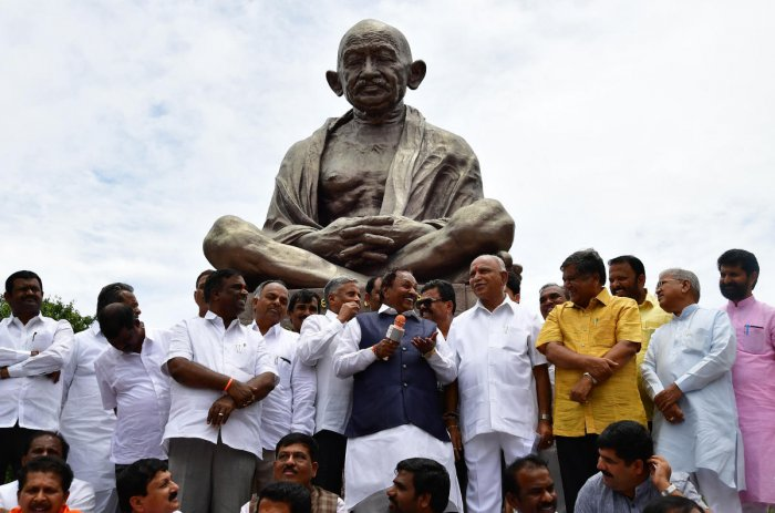 BJP leader K S Eshwarappa addresses party MLAs during a dharna demanding resignation of Chief Minister Kumaraswamy, in front of the Mahatma Gandhi statue on Vidhana Soudha premises, in Bengaluru on Wednesday. DH Photo