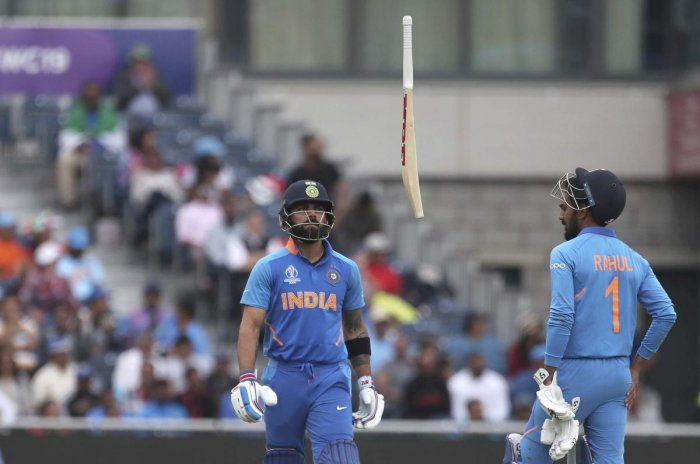 END OF THE ROAD: India's captain Virat Kohli (left) throws his bat in frustration after being dismissed by New Zealand's Trent Boult. AP/PTI