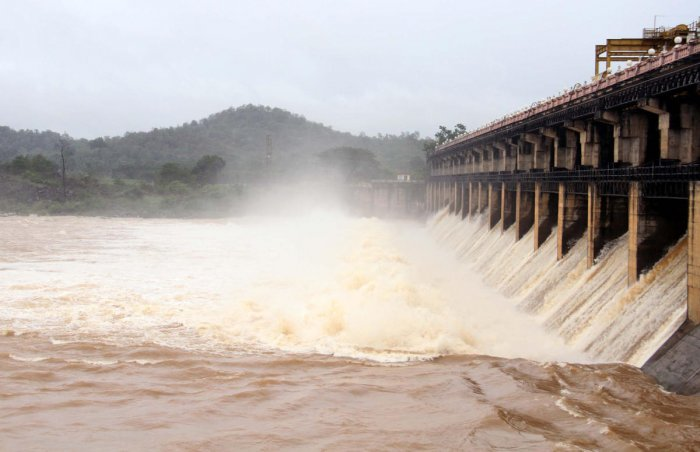 A total of 17,200 cusecs of water was released from 13 crest gates of Tunga dam, at Gajanur in Shivamogga district on Wednesday, after the reservoir reached its maximum level of 588.24 metre. DH PHOTO
