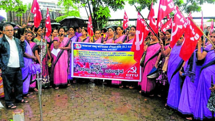 Anganwadi workers from Udupi district stage a protest in front of Deputy Commissioner's office in Manipal on Wednesday.