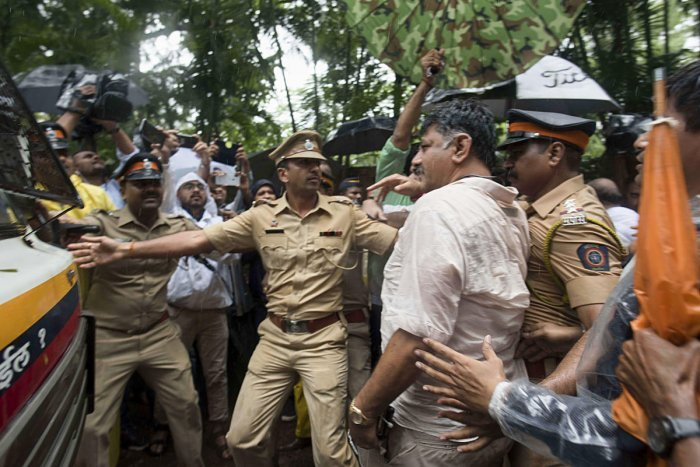 Police escort Water Resources Minister D K Shivakumar to the airport, in Mumbai on Wednesday. PTI