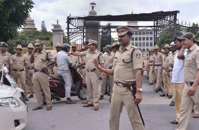 Police personnel stand guard at the entrance of the Vidhana Soudha, in Bengaluru on Thursday. PTI photo