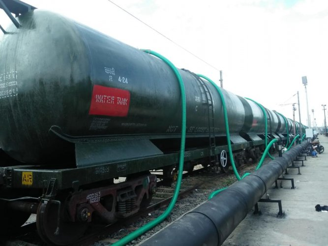 Cauvery water loaded to train wagons ready for transportation to Chennai at the Jollarpettai railway station on Thursday. DH photo